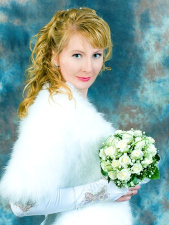 bride portrait with bouquet of flowers in her hand photo