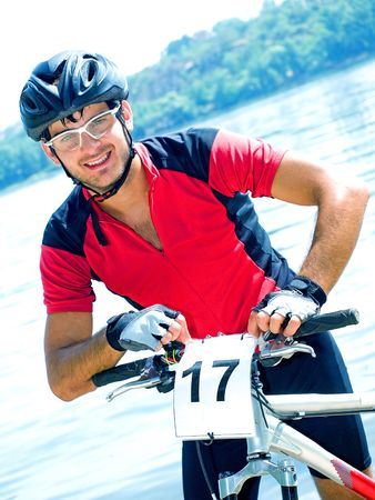 Portrait of cyclist in the protective helmet