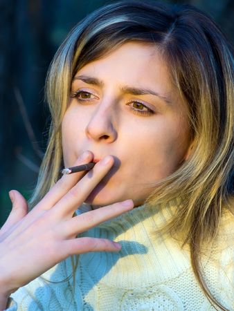 closeup portrait of the smoking young girl  photo