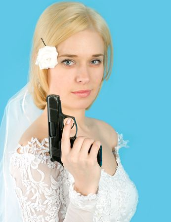Pretty bride with gun isolated on blue Stock Photo - 4637383