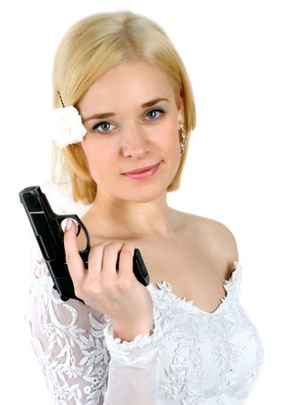 beauty young bride in white dress holding the gun photo