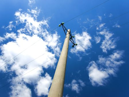 electric grid: Concrete pole with power lines and insulators