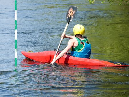 oar: image of the kayaker with an oar on the water