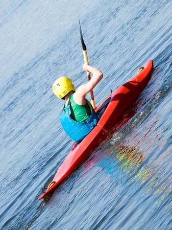 kayaker: image of the kayaker with an oar on the water
