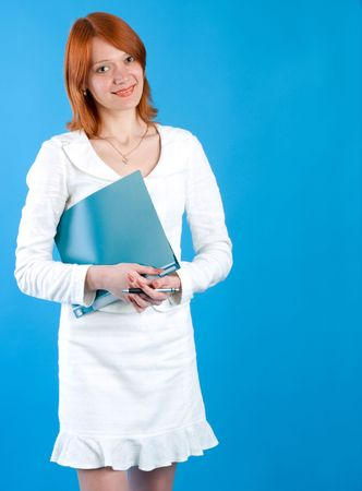 Pretty secretary held folder, isolated on blue background photo