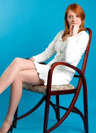allurement: Pretty red girl sitting on high wooden chair