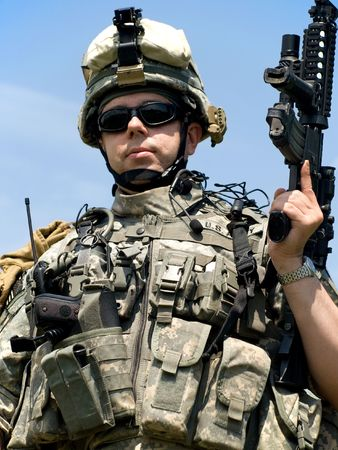US soldier in camouflage uniform with his rifle Stock Photo - 5077535