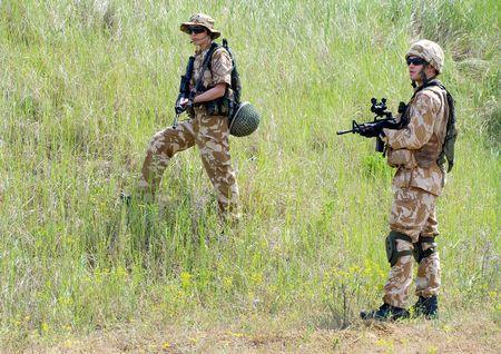 British soldiers in desert uniform in action photo