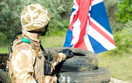 british soldier with the UK flag at the checkpoint Stock Photo