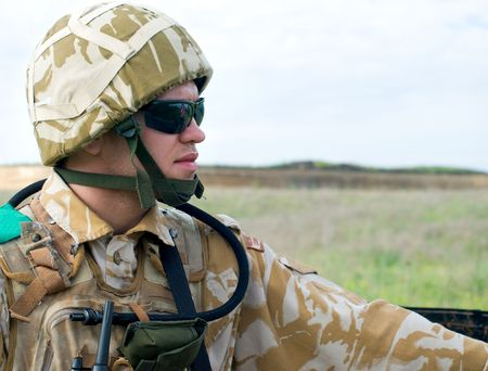acu: British soldier with the reflection of UK flag in glasses looking forward