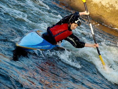 image of the kayaker with an oar on the water