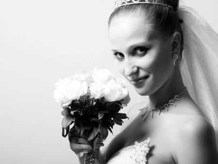 Beautiful bride portrait, with flowers in her hand photo