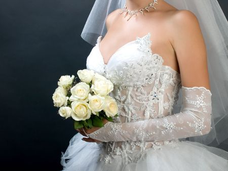 Beautiful bride portrait with flowers in her hand photo
