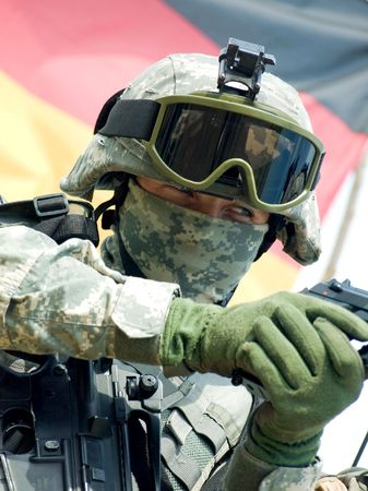 acu: Soldier in camouflage uniform aiming his gun Stock Photo
