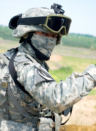 US soldier in camouflage uniform smiling