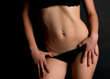 The naked fragment of feminine figure  on a black background Stock Photo - 6863876