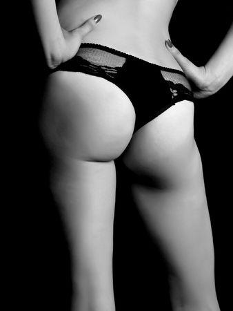 The naked fragment of feminine figure on a black background Stock Photo - 6863871