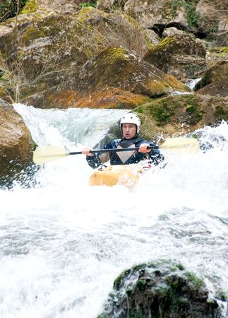 buoyant: a shot of the kayaker with an oar on the water