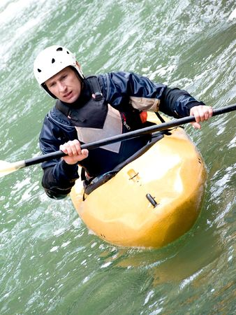 buoyancy: a shot of the kayaker with an oar on the water
