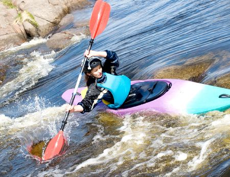 a shot of the female kayaker on the rough water photo