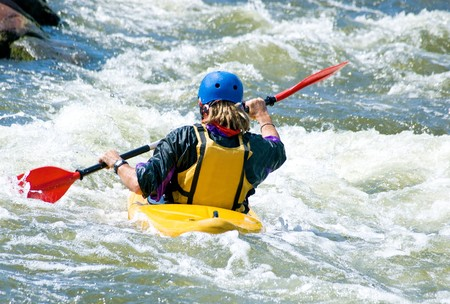 kayaker: a shot of the kayaker on the rough water