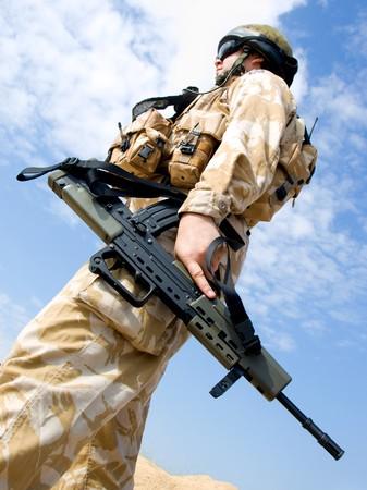 acu: British Royal Commando in desert uniform holding his rifle