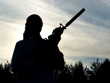 afghan: Silhouette of soldier with rifle