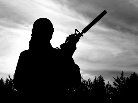 Silhouette of soldier with rifle