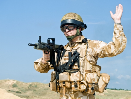 british man: British Royal Commando in action Stock Photo