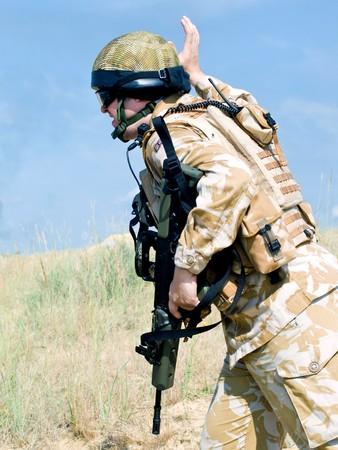 british army: British Royal Commando in action Stock Photo