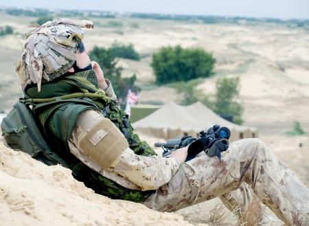 soldier in desert uniform at rest photo