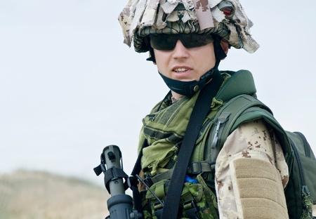 iraq: soldier in desert uniform holding his rifle