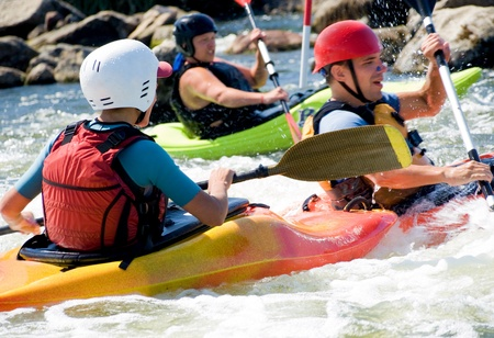 river rafting: active kayakers on the water Stock Photo