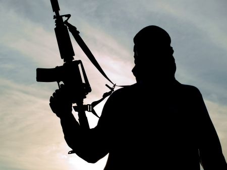 terrorists: Silhouette of soldier with rifle