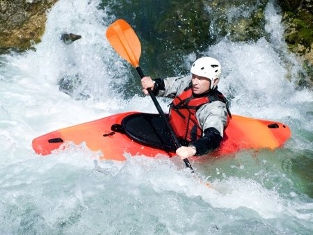 an active kayaker on the rough water Stock Photo - 9187793