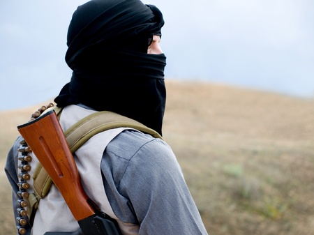 Muslim militant with rifle photo