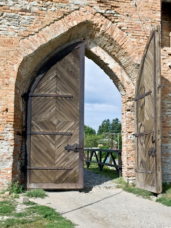 gateway: Massive wooden door of a medieval castle Stock Photo