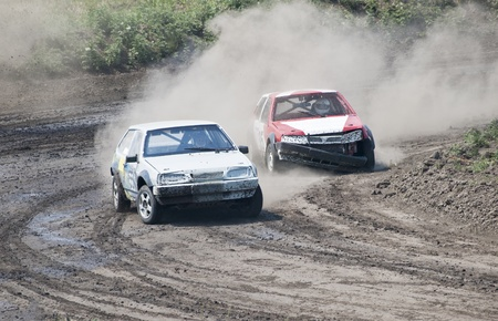 two cars for extreme off-road on the track photo