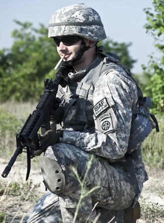 US soldier in action photo