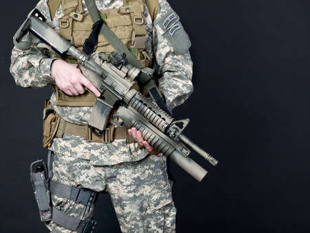 us soldier: US soldier holding his assault rifle