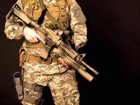 power rangers: US soldier holding his assault rifle
