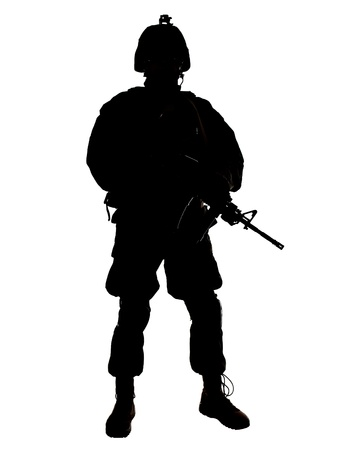 armed services: Silhouette of US soldier with rifle