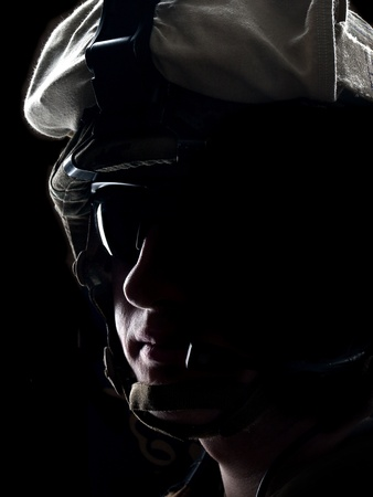 US soldier in the helmet on the black background Stock Photo