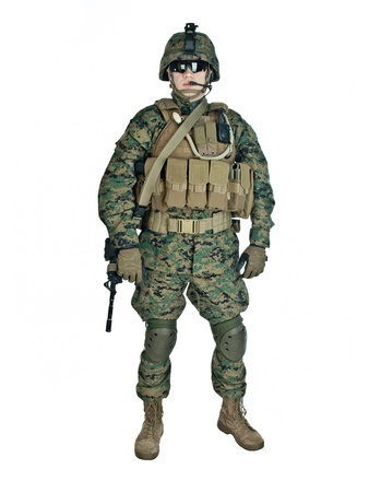 US soldier with his assault rifle on white background photo