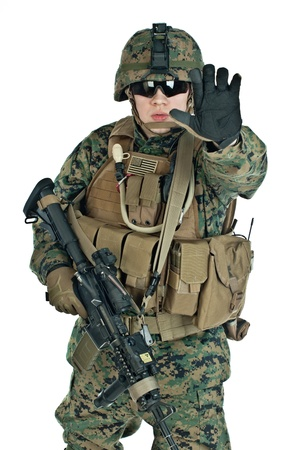 iraq war: The US Soldier showing arm to prevent shooting