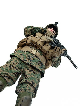 iraq war: US soldier with his assault rifle on white background