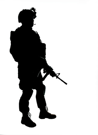 Silhouette of US soldier with rifle photo