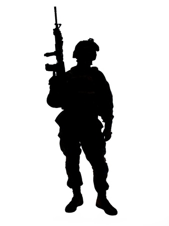 militant: Silhouette of US soldier with rifle
