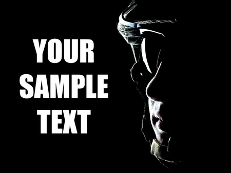 US soldier on the black background with the lot of copyspace Stock Photo