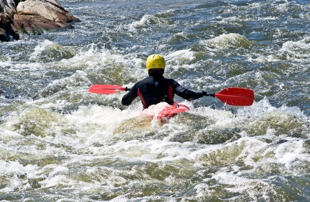 kayaker: an active kayaker fighting with rough water Stock Photo